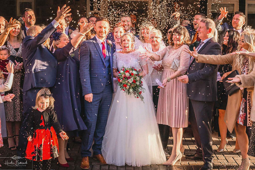 bride and groom group shot confetti the woodman inn leeds Yorkshire wedding photographer