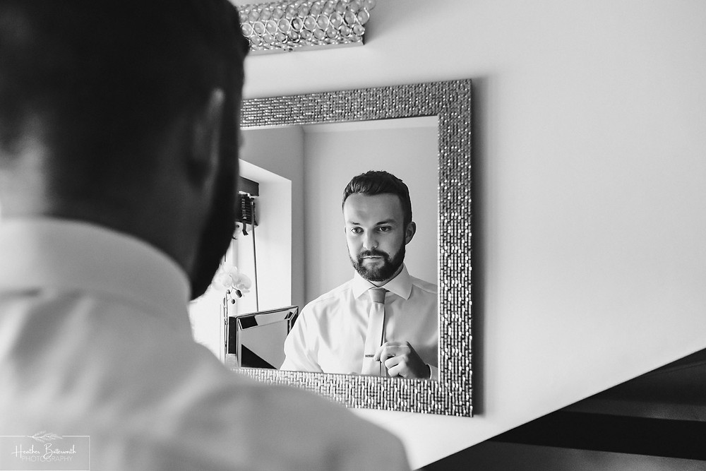 Andy the groom during groom preparations at The Burnside Hotel and Spa in Bowness-on-Windermere