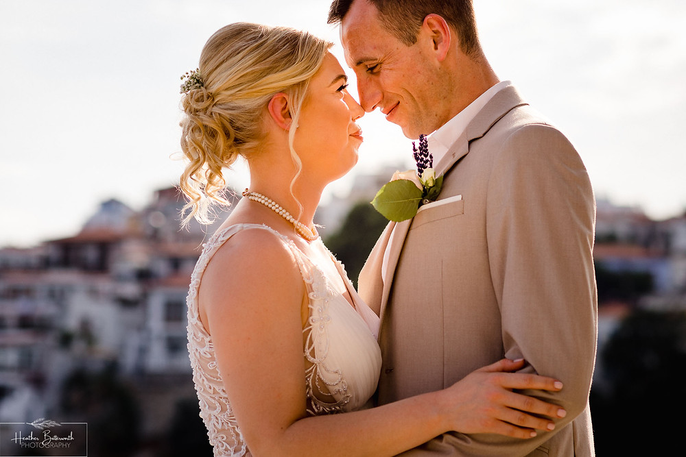 bride and groom together on the beach in skiathos town after their wedding ceremony in June 2019
