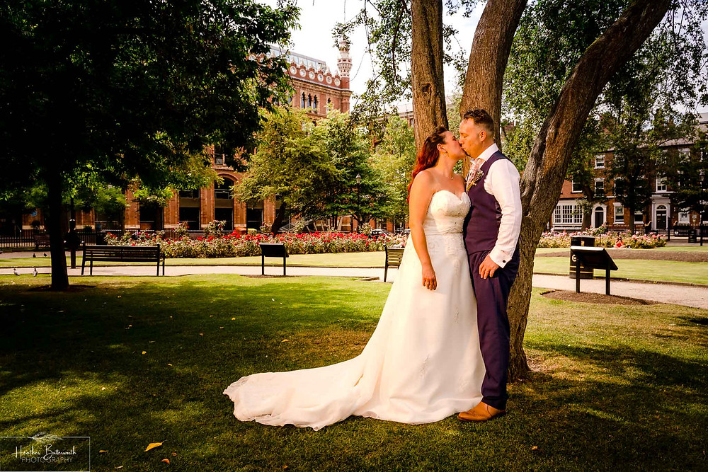 bride and groom in Park Square in Leeds after their wedding ceremony at Leeds Town Hall in August 2020
