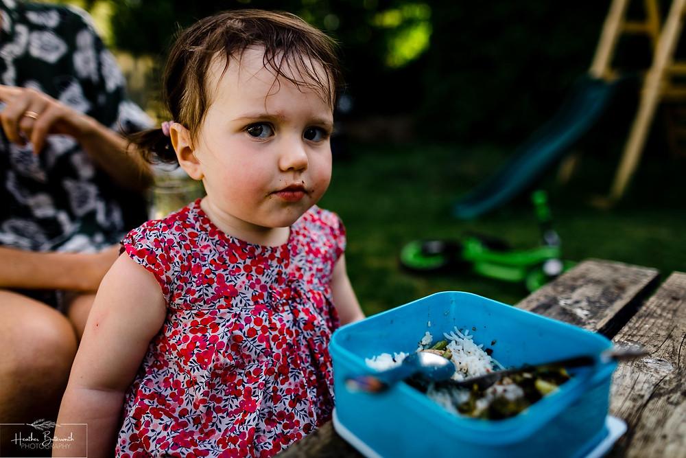 toddler having tea in the garden