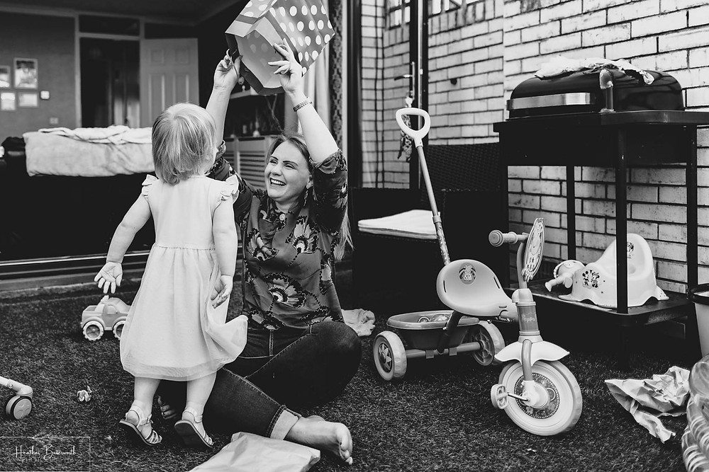 little girl playing with her mum at her second birthday party