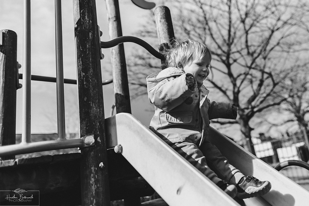 toddler on a slide