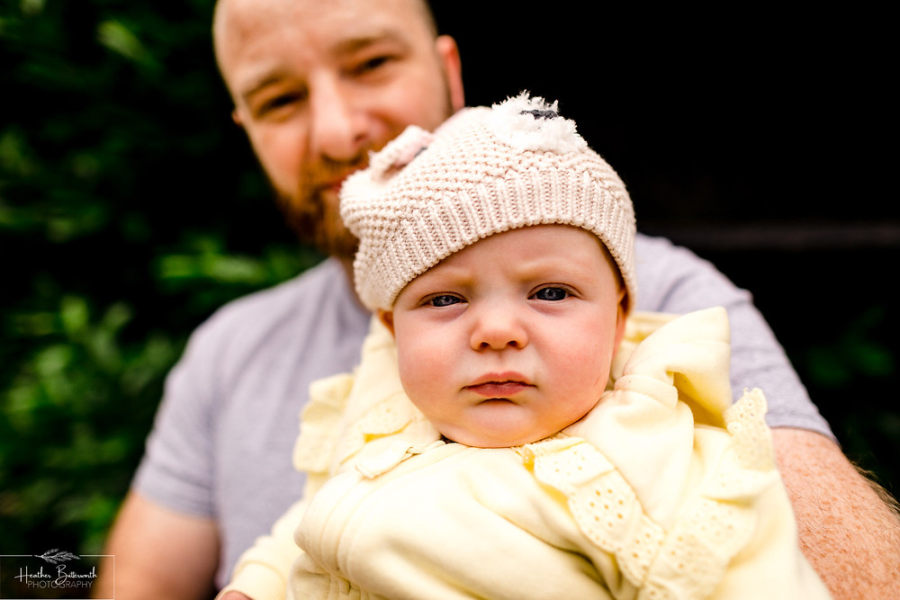 father and baby daughter together in the garden after lockdown restrictions were lifted in June 2020