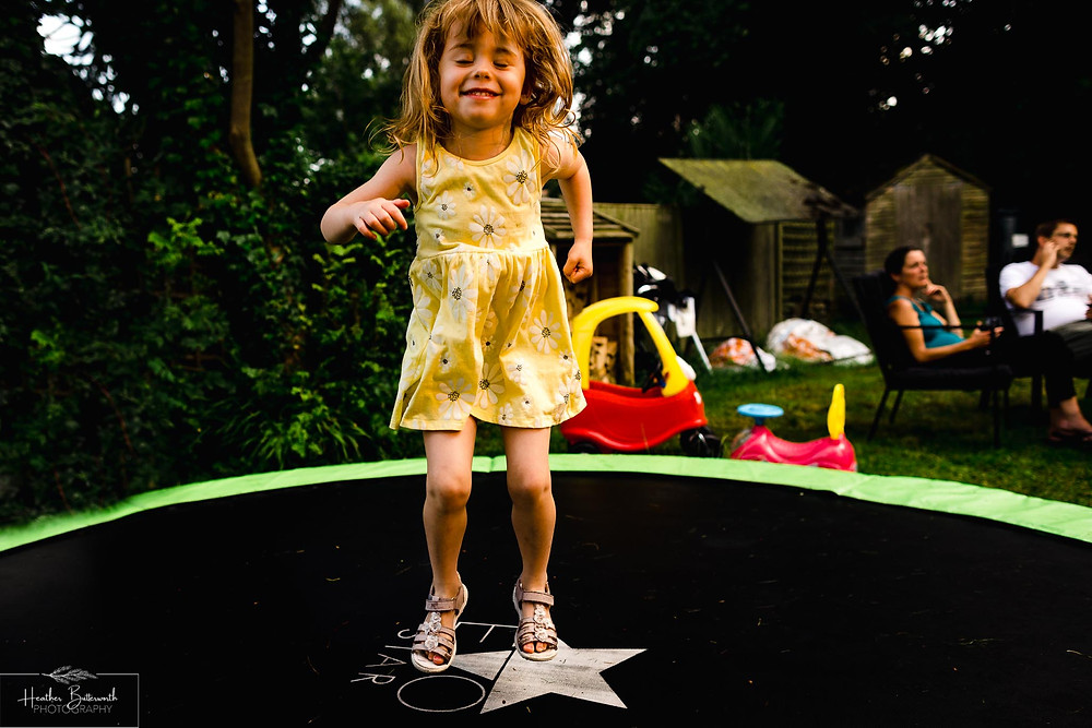 child playing on a trampoline in leeds yorkshire in july 2020