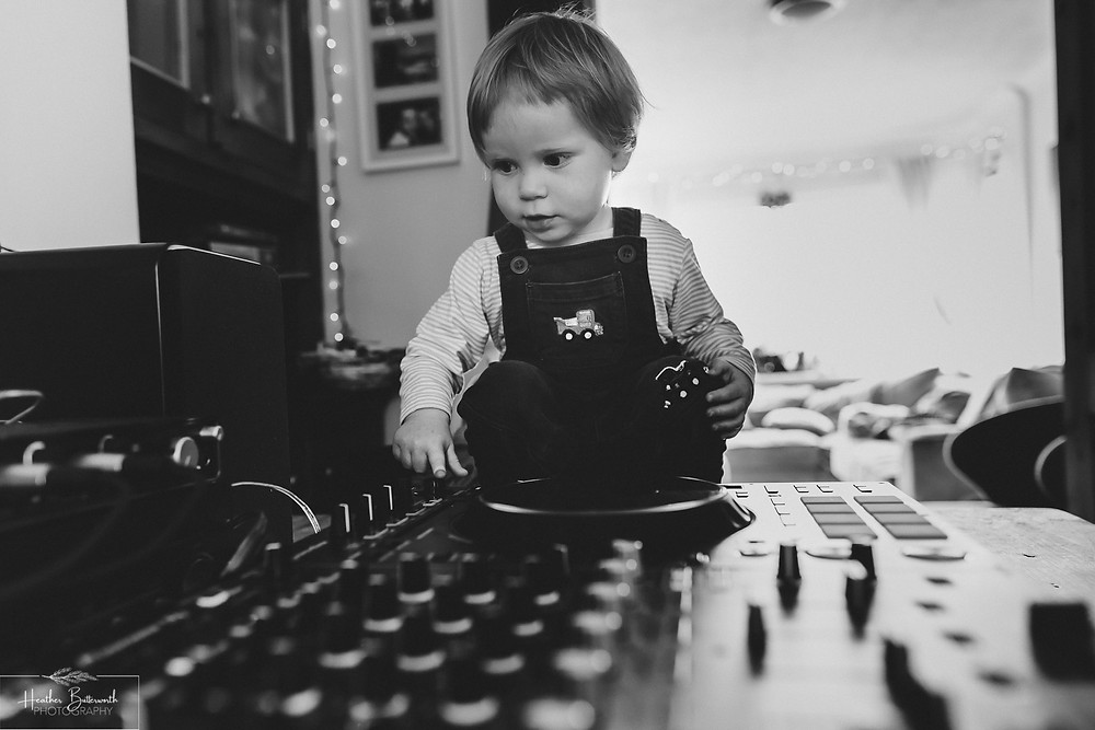 documentary family photography taken during lockdown in 2020 in Leeds Yorkshire by Photographer Heather Butterworth of a boy playing with DJ equipment