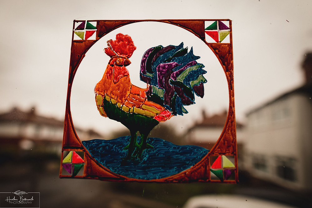 drawing of a rooster on glass with chalk markers