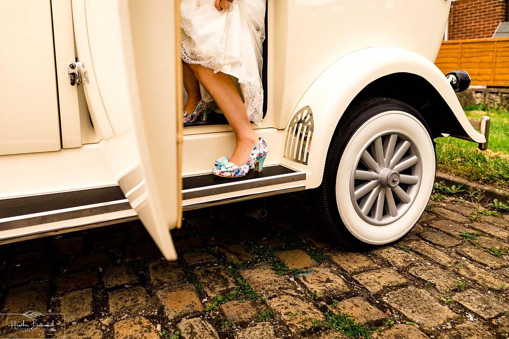 brides feet getting in her wedding car n Leeds Yorkshire UK in august 2020
