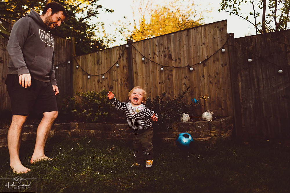documentary family photography taken during lockdown in 2020 in Leeds Yorkshire by Photographer Heather Butterworth of boy and dad playing football