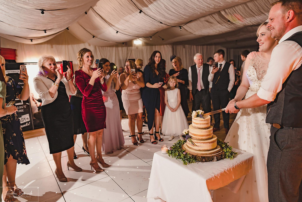 leeds wedding photographer reception Yorkshire alwoodley community hall cut the cake