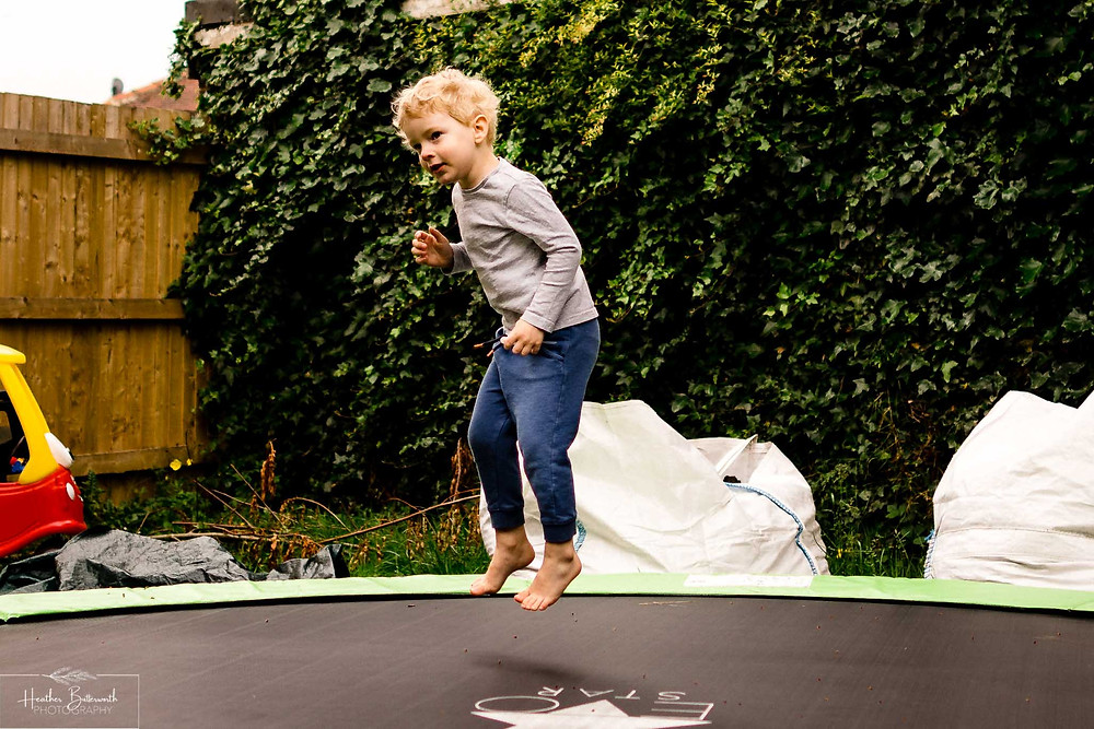 boy bouncing on a trampoline