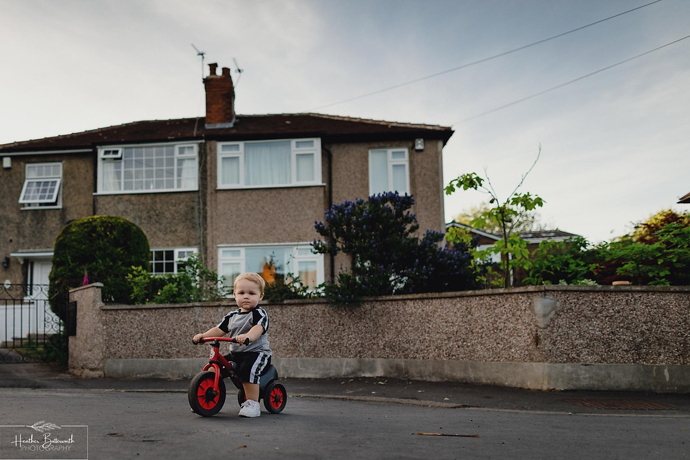 Toddler in the street social distancing after the COVID-19 lockdown in June 2020 in Yorkshire