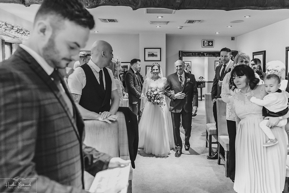 bride coming down the wedding aisle at the woodman inn Yorkshire leeds photographer
