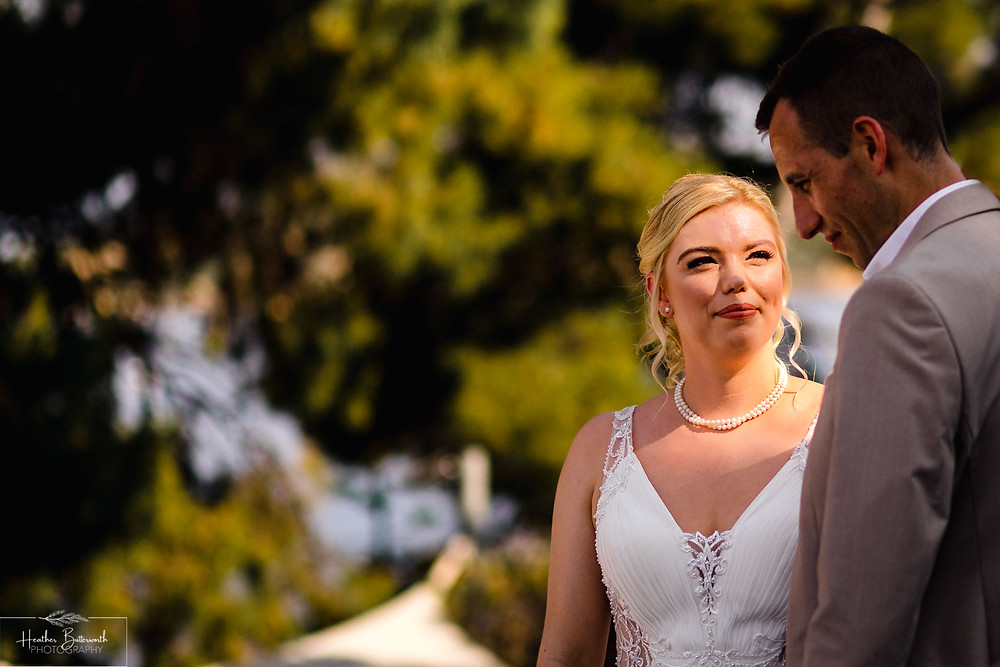 bride and groom during their wedding ceremony at The Boutzi wedding venue in Skiathos Town in June 2019