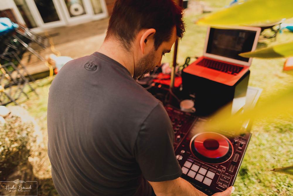 man DJing in the garden