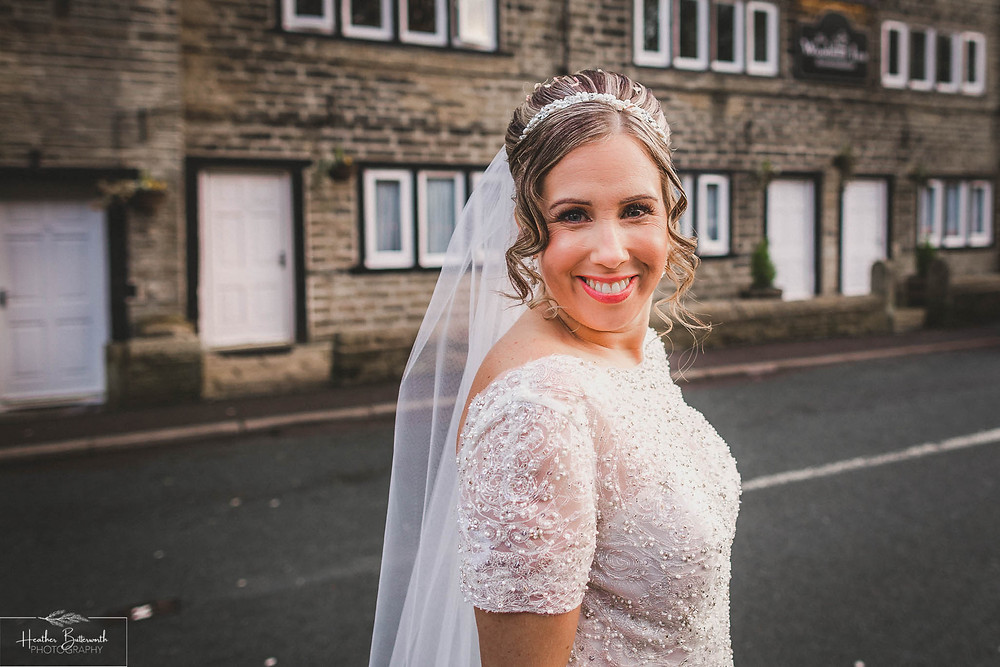 Bride after her wedding ceremony at The Woodman Inn in Thunderbridge, Yorkshire