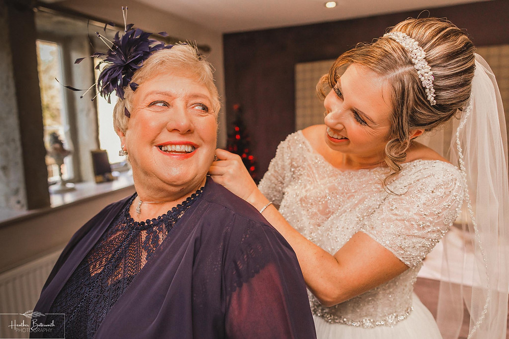 bridal preparation mother of bride before the wedding at the woodman inn Yorkshire leeds photographer