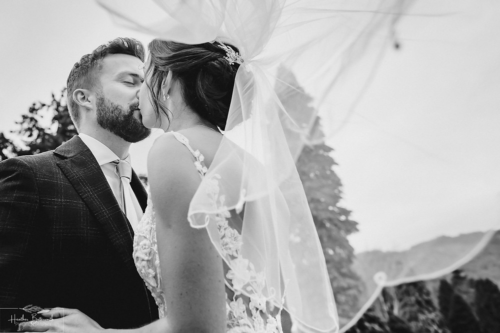 Bride Bex with her new husband Andy in the garden in monochrome at The Burnside Hotel and Spa in Bowness-on-Windermere