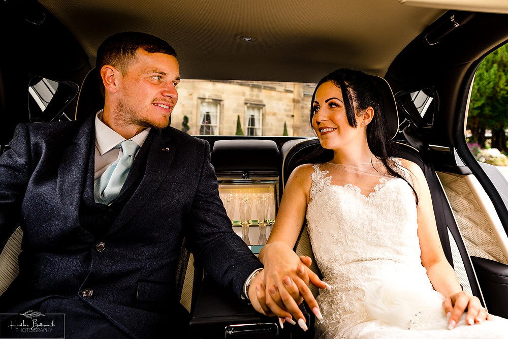 A bride and groom in their Bentley Mulsanne outside Grantley Hall, Yorkshire in July 2020