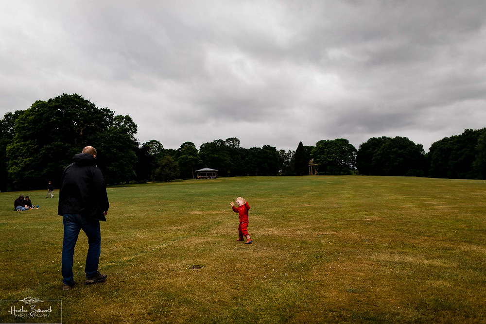 father and son playing in roundhay park after restrictions were slightly lifted after the COVID-19 lockdown in Leeds , Yorkshire in June 2020