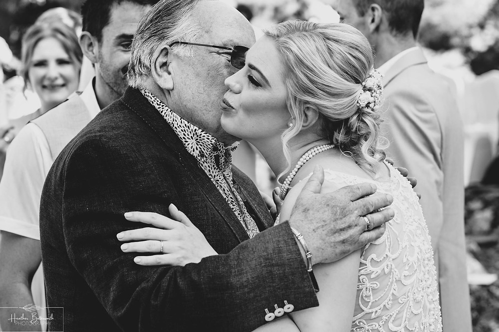 bride greats her new father in law after her wedding in Skiathos Town in June 2019
