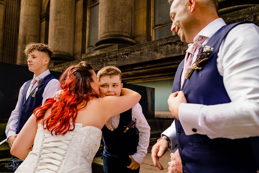 bride arriving outside Leeds Town Hall and kissing her son before her wedding ceremony in Yorkshire in August 2020