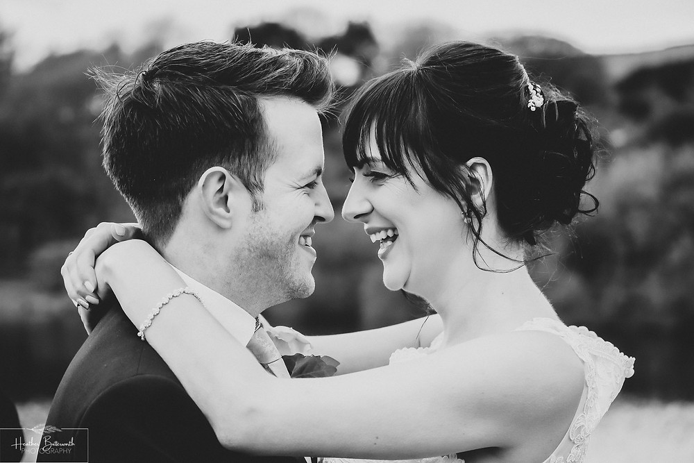 A happy bride and groom looking into each others eyes after their wedding ceremony at Moorlands Inn, Halifax, Yorkshire