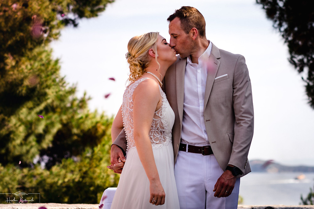 bride and groom kissing after their wedding in skiathos town Greece in June 2019