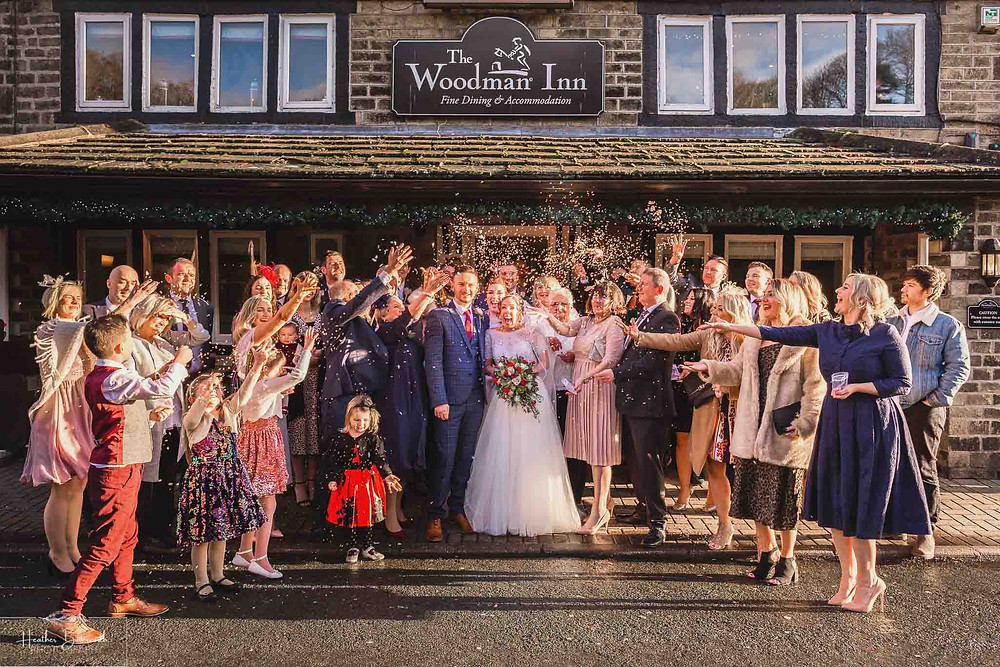 group confetti shot after the wedding ceremony at the woodman inn Yorkshire leeds wedding photographer