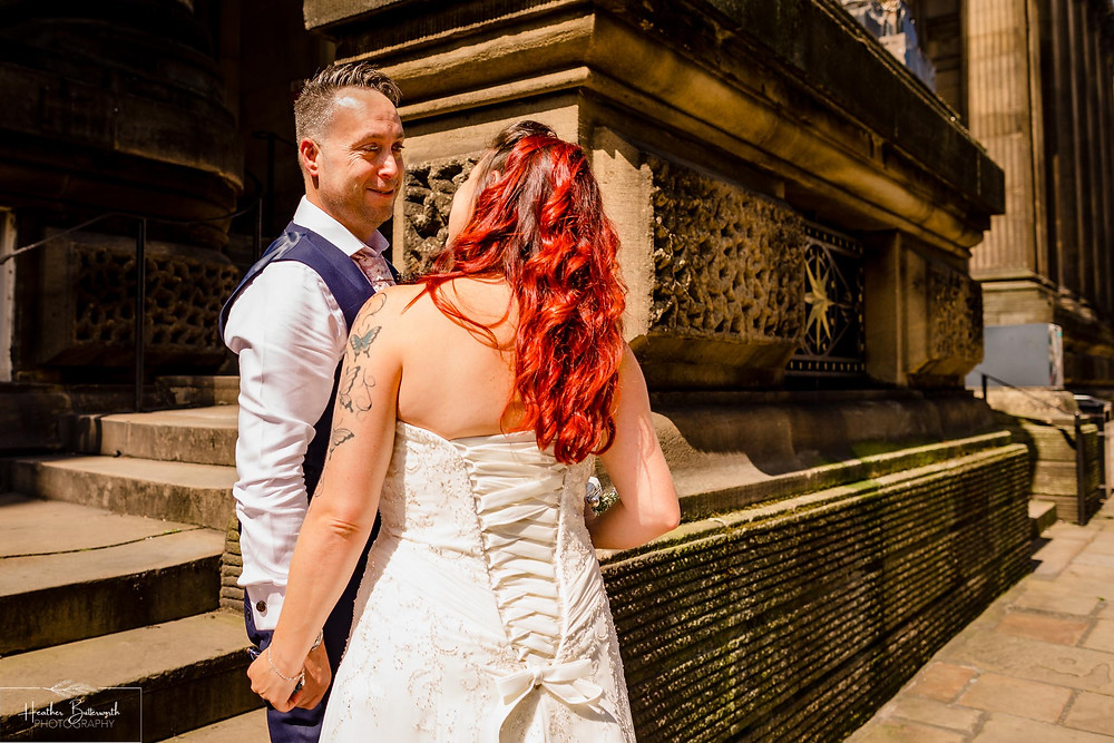 bride arriving outside Leeds Town Hall and kissing the groom before her wedding ceremony in Yorkshire in August 2020