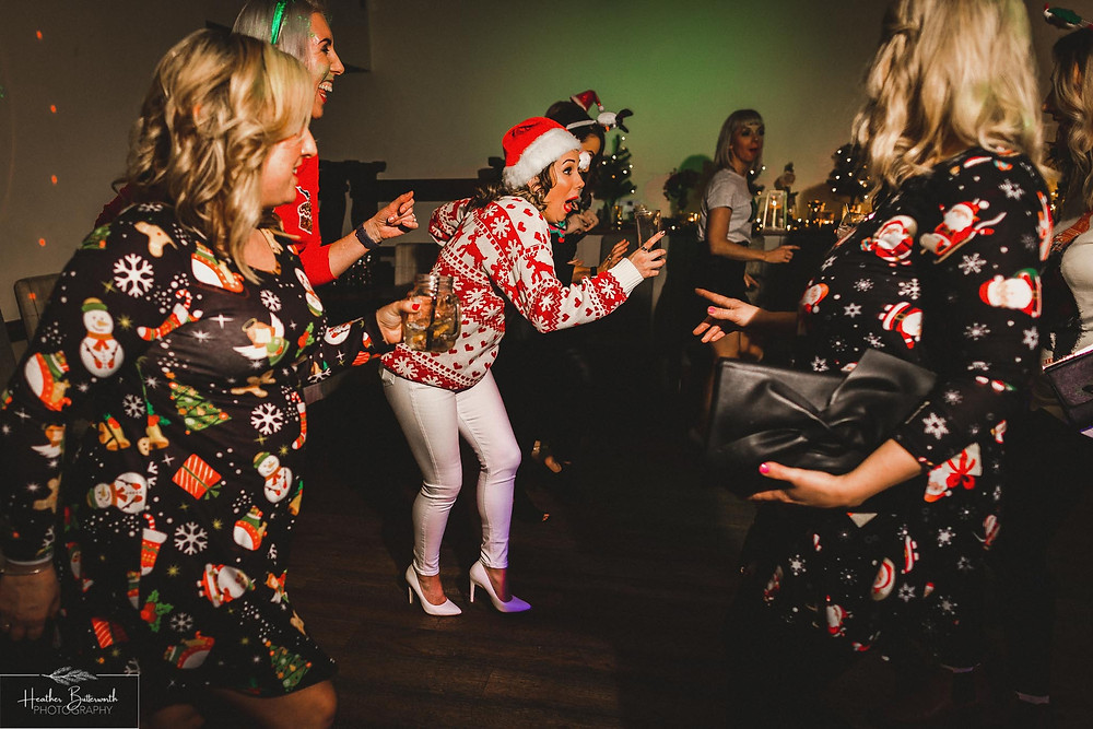 Bride laughing and dancing with her friends at The Woodman Inn in Thunderbridge, Yorkshire