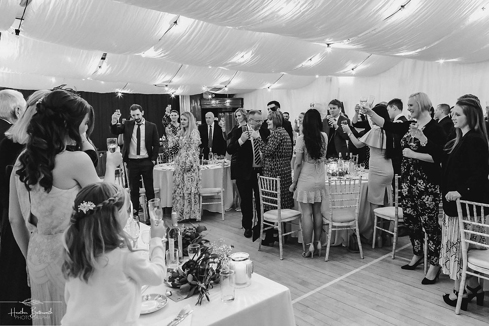 leeds wedding photographer Yorkshire reception alwoodley community hall group toast