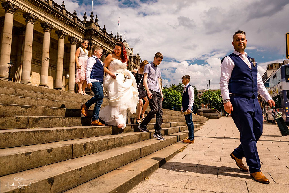 bride and grooms' family after their wedding ceremony at Leeds Town Hall in August 2020