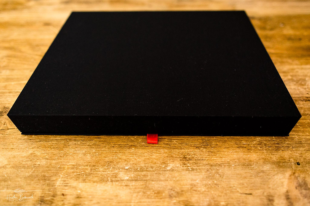 wedding album box on a wooden table by Heather Butterworth photography