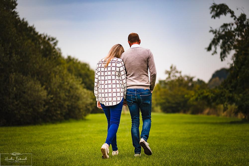 golden acre park Leeds wedding photographer engagement shoot grass