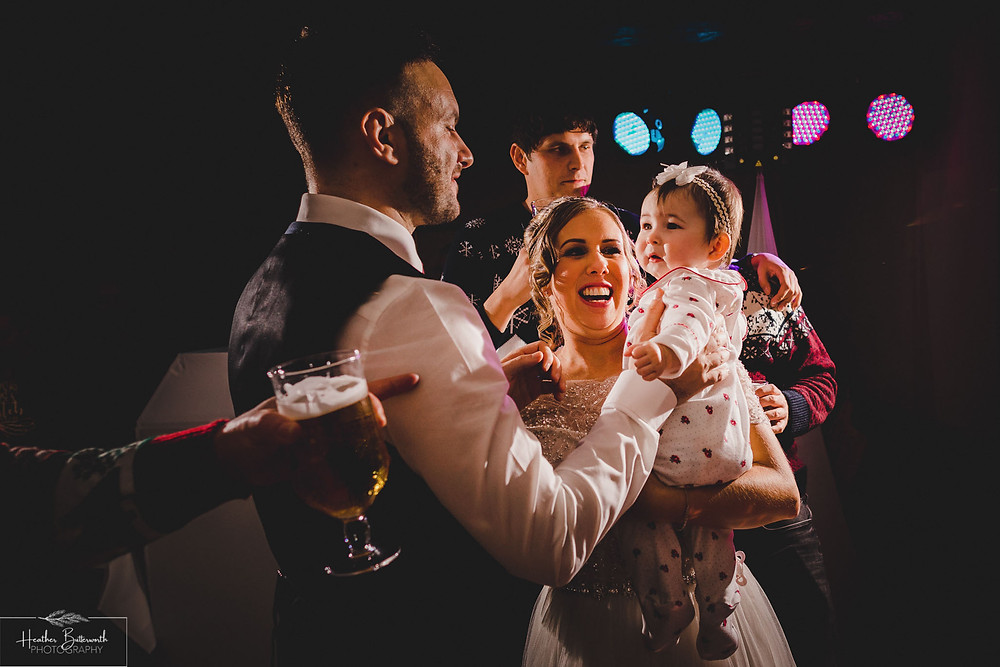 Bride dancing with her baby and new husband at The Woodman Inn in Thunderbridge, Yorkshire