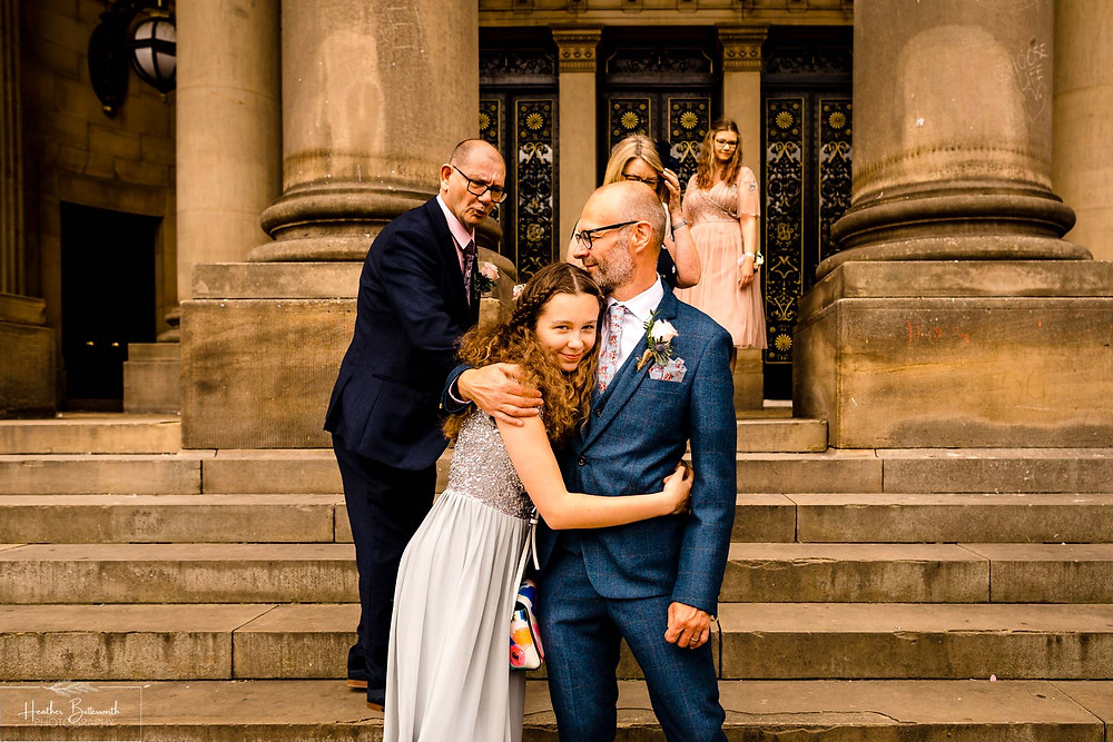 groom with his daughter at Leeds Town Hall after his wedding in august 2020