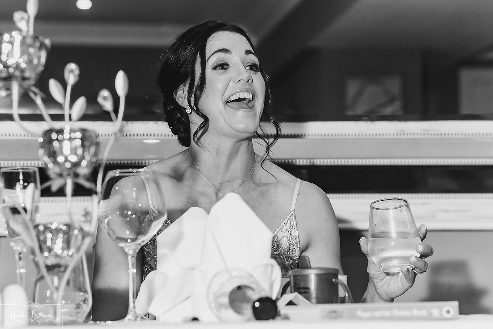 Bridesmaid laughing during the speeches at The Burnside Hotel and Spa in Bowness-on-Windermere