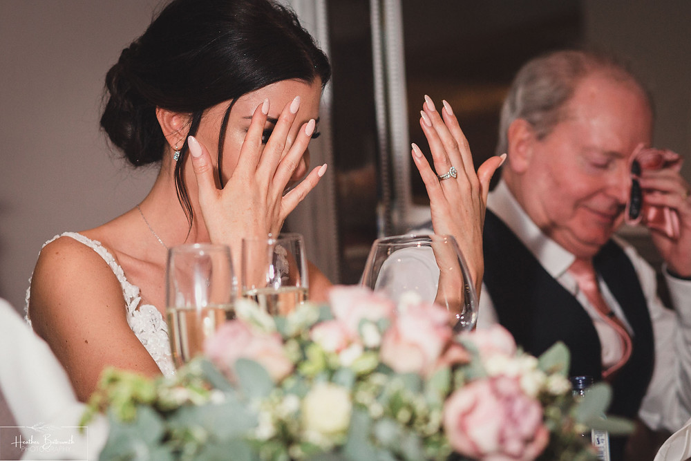 Bex the bride reacting during the speeches at The Burnside Hotel and Spa in Bowness-on-Windermere
