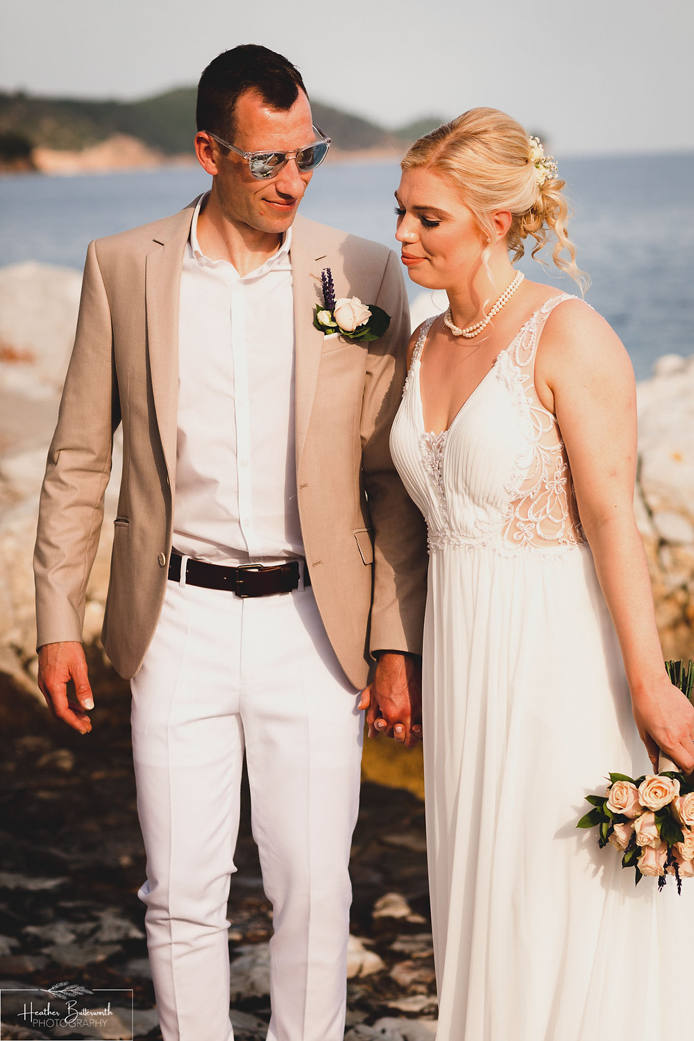 natural photo of the bride and groom relaxing on the beach in skiathos