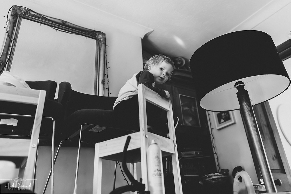documentary family photography taken during lockdown in 2020 in Leeds Yorkshire by Photographer Heather Butterworth of a toddler high up on a chair