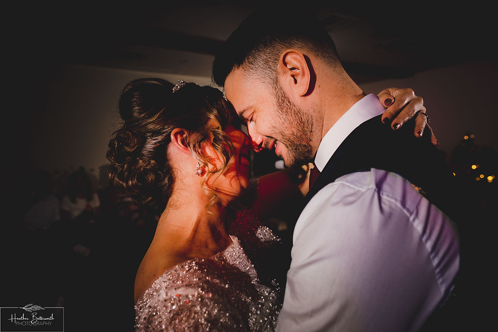 Bride and groom dancing at The Woodman Inn in Thunderbridge, Yorkshire