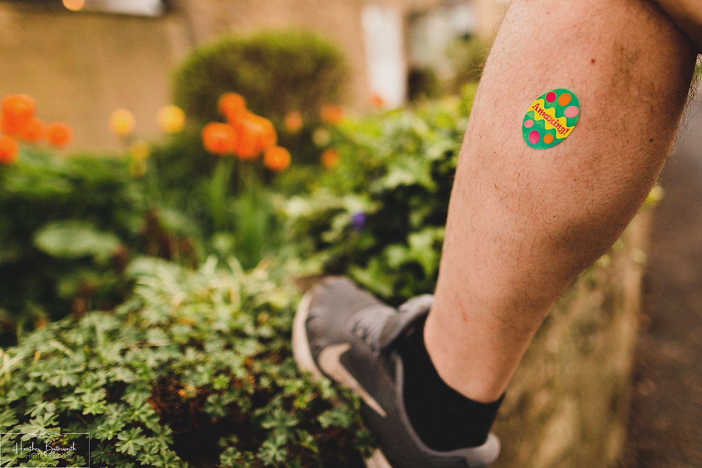 Dad's leg in the family garden in Leeds, Yorkshire. Image by Heather Butterworth Photography
