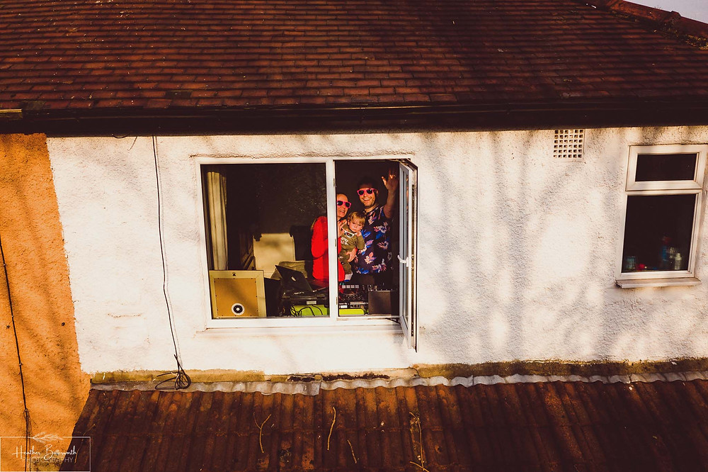 documentary family photography taken during lockdown in 2020 in Leeds Yorkshire by Photographer Heather Butterworth of a family at a window