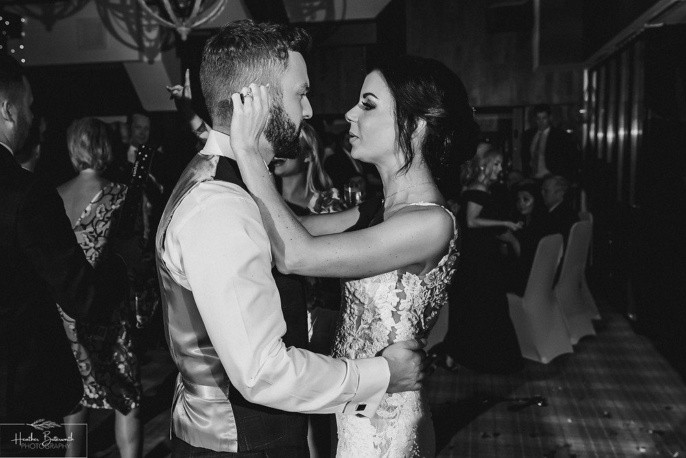 Bride Bex and Groom Andy dancing together in monochrome at their evening reception at The Burnside Hotel and Spa in Bowness-on-Windermere