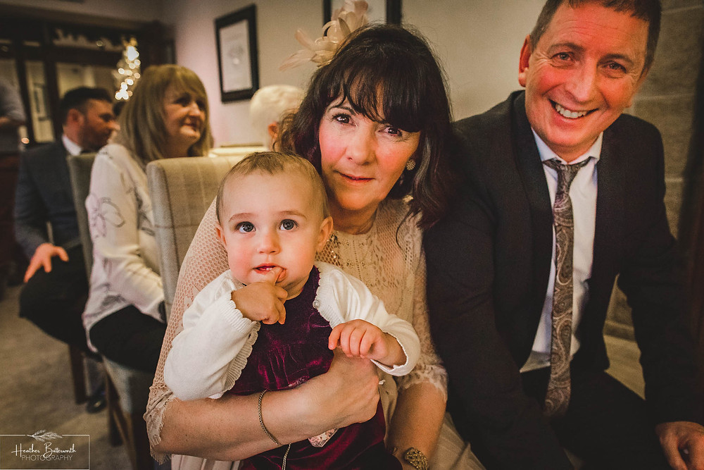 Family of the Bride and Groom during their wedding ceremony at The Woodman Inn in Thunderbridge, Yorkshire