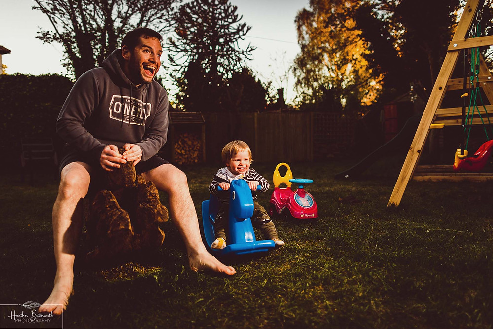 documentary family photography taken during lockdown in 2020 in Leeds Yorkshire by Photographer Heather Butterworth of boy and dad on rocking horses