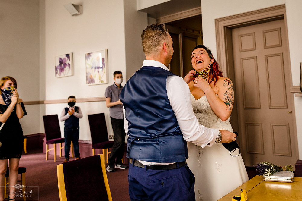 bride and grooms wedding ceremony at Leeds Town Hall in Yorkshire in August 2020