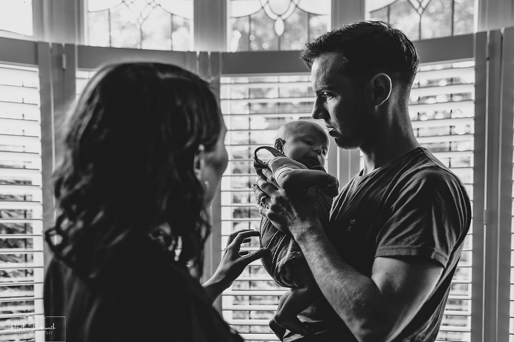 family portrait photography of a mother father and new eight week old baby at home in Leeds Yorkshire UK in July 2020