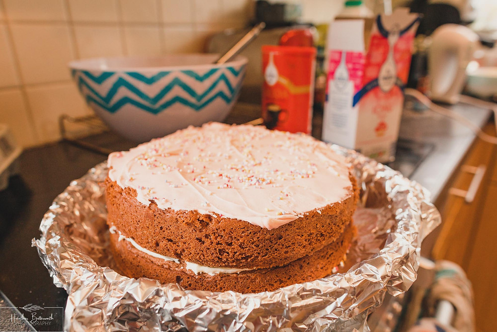 a chocolate cake with pink icing